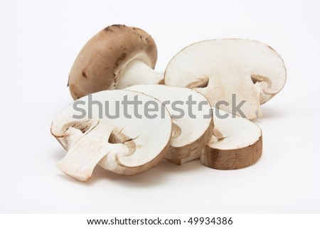 Chestnut Mushrooms from low viewpoint isolated against white background.