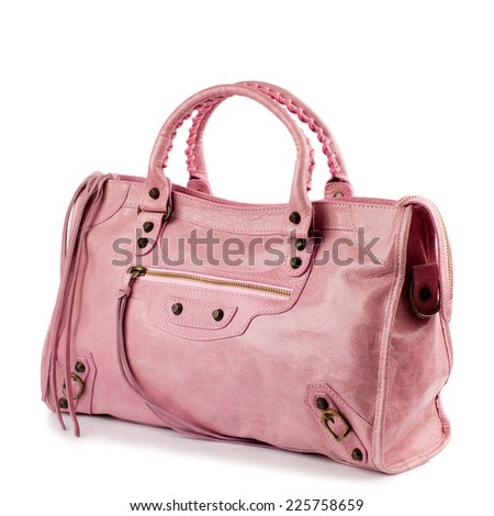 Chestnut patent female leather bag isolated on white background.