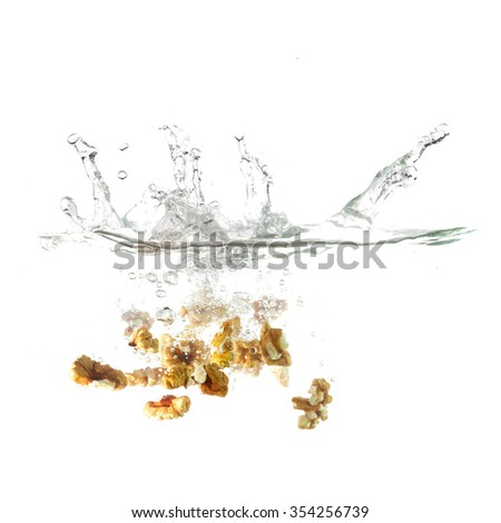 Chestnut splash on water, isolated on white background. Use for advertising raw food or fresh drinks. Advertising cocktails. Being shot as they submerged under water. Healthy form of product promotion
