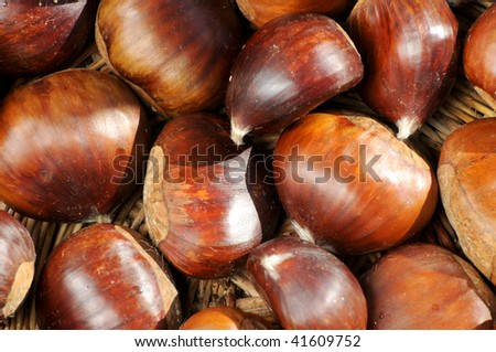 chestnuts framed in a traditional basket - stock photo