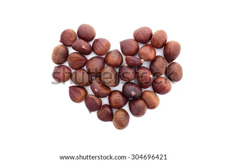 Chestnuts in a heart shape, isolated on a white background - stock photo