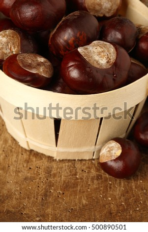 chestnuts in a small basket, shallow dof