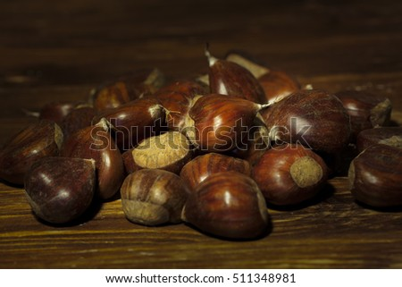 Chestnuts on a gooden table