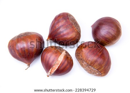 Chestnuts on a white background seen from above - stock photo