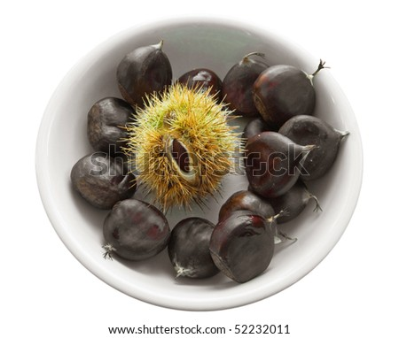 Chestnuts on white dish. - stock photo
