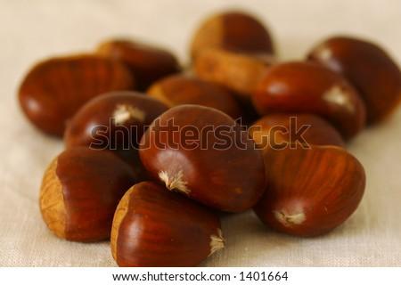 Chestnuts. Shallow DOF. - stock photo