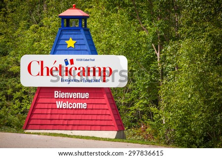CHETICAMP, CANADA - AUGUST 23: Welcome sign of the small village of Cheticamp, in the Cabot Trail on August 23, 2014 in Cheticamp, Nova Scotia, Canada