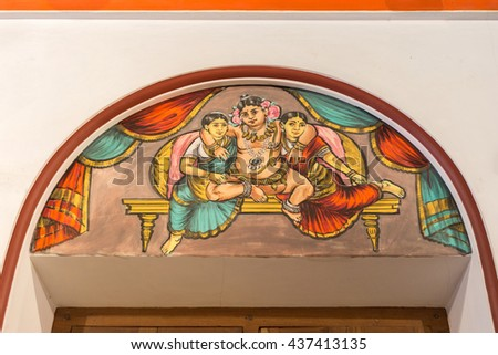 Chettinad, India - October 17, 2013: Chidambara Palace in Kadiapatti. Wall painting above door showing Krishna in the company of two of his wives, Rukmini and Satyabhama. - stock photo