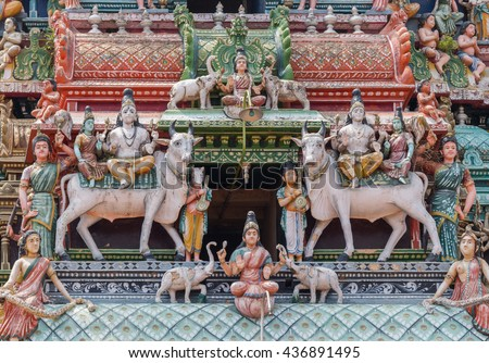 Chettinad, India - October 17, 2013:Detail of the Shiva temple gopuram at Kottaiyur shows twice Shiva and Parvati sitting on Nandi the bull. Above and beneath is Lakshmi showered by elephants. - stock photo