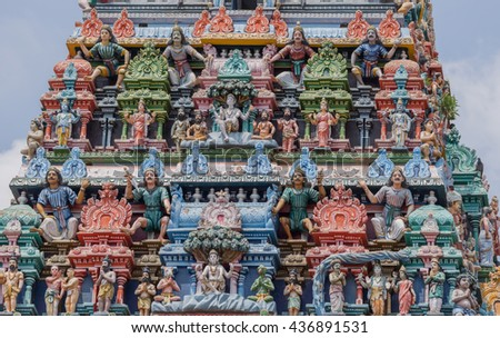 Chettinad, India - October 17, 2013:Detail of the Shiva temple gopuram at Kottaiyur shows twice Shiva as supreme teacher known as Dakshinamurthy. Plenty of colorful statues.