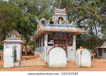 Chettinad, India - October 17, 2013: Kothamangalam Ayyanar horse shrine. Small Lord Shiva shrine showing him and his two sons, Ganesha and Murugan. Ayyanar figures on the corners with nandi the bull. - stock photo