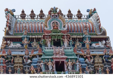 Chettinad, India - October 17, 2013:The Kalasha, the top of Gopuram at Shiva temple in Kottaiyur. Loaded with Hindu-themed colorful statues with Lakshmi on top and center. - stock photo