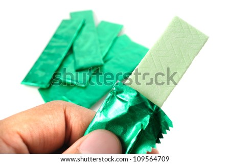 chewing gum and the wrapping foil on white - stock photo