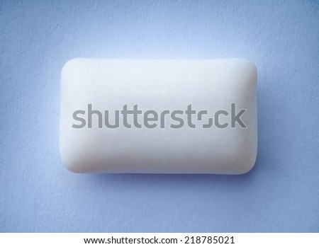 Chewing gum on blue background - stock photo