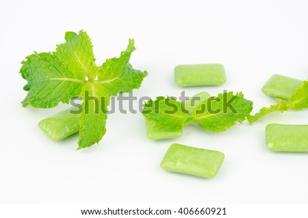 chewing gum with mint leaf on white background - stock photo