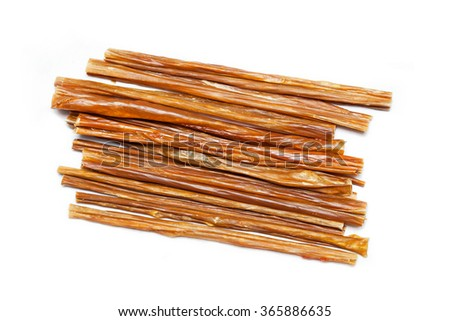 chewing sticks for pets isolated on white background - stock photo