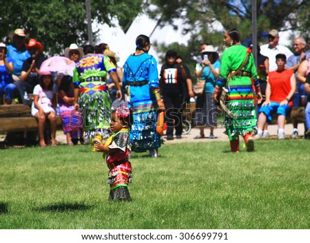 CHEYENNE, WYOMING - July 25, 2015 - Young Native American girl clapping at a pow-wow - stock photo
