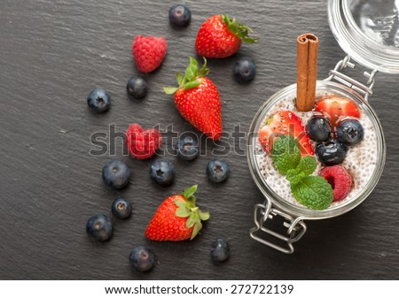 Chia pudding with coconut milk and berries. top view - stock photo