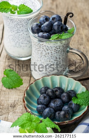 Chia seed pudding made with blueberries vanilla and mint on a wooden background. Selective focus. The concept of good nutrition - stock photo