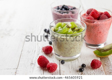 Chia seed pudding with various fruit and berries for healthy morning meal, selective focus,