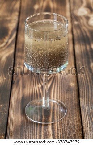 Chia seeds drink in a wine glass. Shallow dof - stock photo