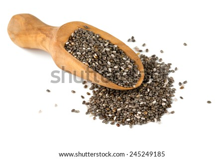 chia seeds in a wooden scoop isolated on white - stock photo