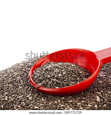 chia seeds in red scoop close up isolated on white - stock photo