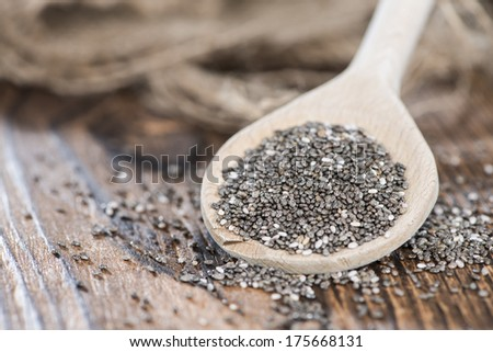 Chia Seeds on a wooden spoon (detailed close-up shot) - stock photo