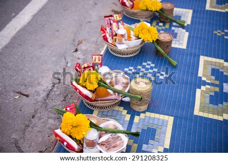 CHIANG KHAN, THAILAND - JUNE 27, 2015: Unidentified tourists offering sticky rice to Buddhist monk and Buddhist novice in the morning on June 27, 2015 at Chiang Khan, Loei, Thailand. - stock photo