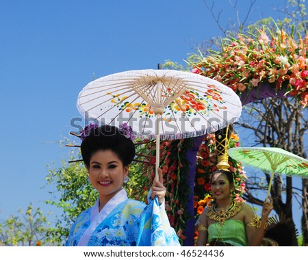 CHIANG MAI - FEB 6: Traditionally dressed girl in procession on Chiang Mai 34th Flower Festival on February 6, 2010 in Chiang Mai, Thailand - stock photo