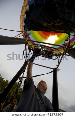 CHIANG MAI - NOV 26: Unidentified man fills hot air in balloon during Thailand balloon festival 2011 at Prince Royal college in Chiang mai, Thailand on Nov 26, 2011.