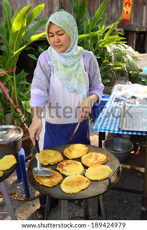 CHIANG MAI, THAILAND-APR25 : Native muslim female merchant preparing thai homemade dessert to sale  in a local halal food market in chiang mai, On Apr 25, 2014, in Chiang Mai, Thailand.