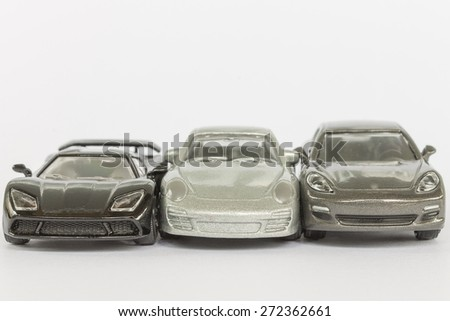 CHIANG MAI ,THAILAND - APRIL 25 2015: Car (small) toys  Miniature representation of porsche on white background ,produced as children toys