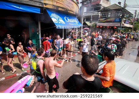 CHIANG MAI THAILAND-APRIL 13:Chiang mai Songkran festival. Foreign tourists and Thai people enjoy splashing water. on April 13,2014 in Chiang mai,Thailand.