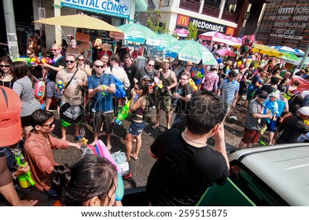 CHIANG MAI THAILAND-APRIL 13:Chiang mai Songkran festival. Foreign tourists and Thai people enjoy splashing water. on April 13,2014 in Chiang mai,Thailand. - stock photo