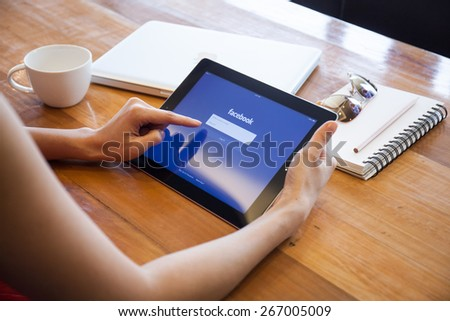 CHIANG MAI, THAILAND - APRIL 5, 2015: Facebook application sign in page on Apple iPad. Facebook is largest and most popular social networking site in the world. - stock photo