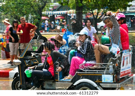 CHIANG MAI, THAILAND - APRIL 13: Girls rides a tuk-tuk on April 13, 2010 in Chiang Mai, Thailand. Celebration of Thai New Year (Songkran water festival)  in 2010.