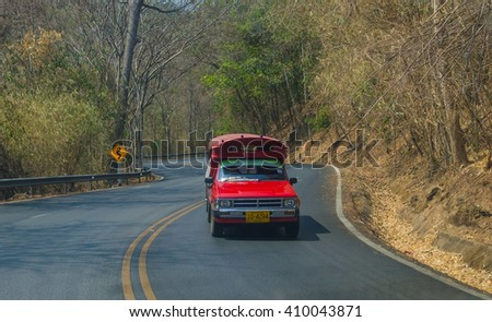 CHIANG MAI, THAILAND-APRIL 23,2016: Red taxi chiang mai, Service in city and around chiang mai, thailand - stock photo
