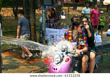 CHIANG MAI, THAILAND - APRIL 13: Thai girls rides bike on April 13, 2010 in Chiang Mai, Thailand. Celebration of Thai New Year (Songkran water festival) in 2010.