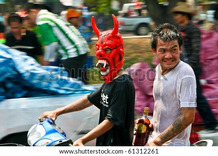 CHIANG MAI, THAILAND - APRIL 13: Thai guys ride a bike on April 13, 2010 in Chiang Mai, Thailand. Celebration of Thai New Year (Songkran water festival)  in 2010.