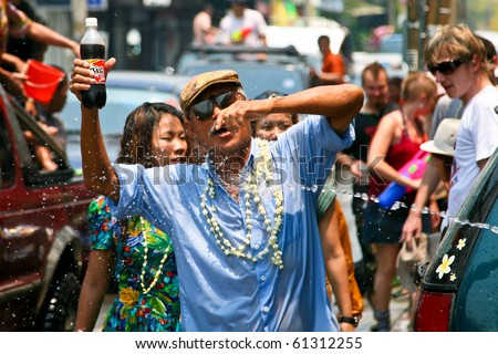CHIANG MAI, THAILAND - APRIL 13: Thai old man gets fun on April 13, 2010 in Chiang Mai, Thailand. Celebration of Thai New Year (Songkran water festival)  in 2010.