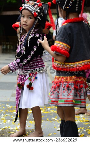 CHIANG MAI, THAILAND - APRIL 2014: The Hmong children posing for photograph at Doi Suthep Temple. The Hmong are an Asian ethnic group from the mountainous regions of China, Vietnam and Thailand.
