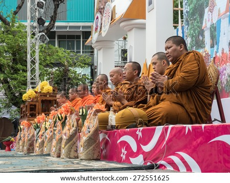 CHIANG MAI, THAILAND - APRIL 13 2015: The official opening ceremony of Songkran (Thai New Year Festival). This is marked by the monks receiving the traditional alms in Chiang Mai City, Thailand. - stock photo