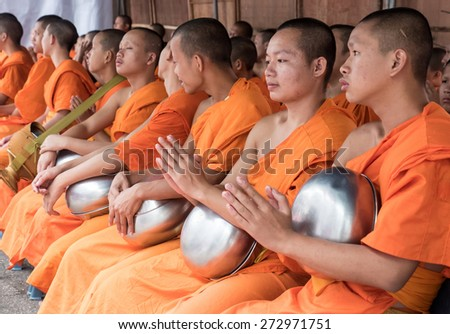 CHIANG MAI, THAILAND - APRIL 13 2015: The official opening ceremony of Songkran (Thai New Year Festival). This is marked by the monks receiving the traditional alms in Chiang Mai, Thailand. - stock photo