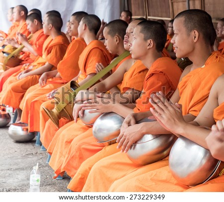 CHIANG MAI, THAILAND - APRIL 13 2015: The official opening ceremony of Songkran (Thai New Year ). This is marked by the monks receiving the traditional alms in Chiang Mai , Thailand. - stock photo