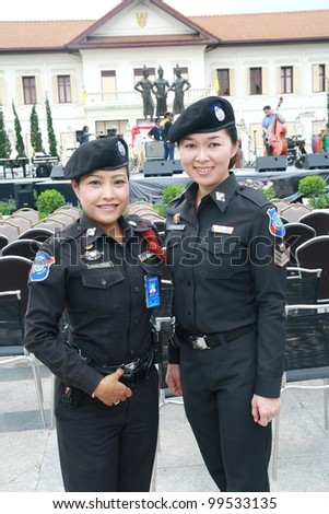 CHIANG MAI,THAILAND-APRIL 7:Unidentified women  police at 3kings monument  on the Chiang Mai Fest&Art on the street festival,On April 7, 2012 in Chiang Mai, Thailand. - stock photo