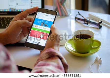 CHIANG MAI,THAILAND DEC 30 - 2015 : Amazon web on iPhone 6 plus screen.Amazon.com, Inc. is an American international electronic commerce company. It is the world's largest online retailer. - stock photo