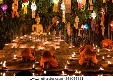 CHIANG MAI, THAILAND - DEC 31: New year festival, Buddhist monk fire candles to the Buddha on Dec 31, 2016 in Phan Tao Temple, Chiangmai, Thailand.