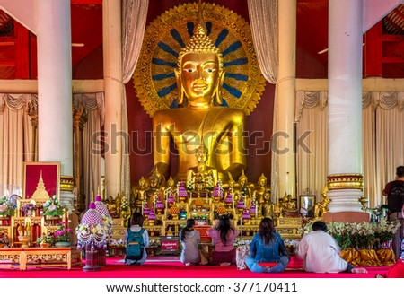 CHIANG MAI, THAILAND - DECEMBER 24, 2013: Buddhist come to worship in the temple. - stock photo