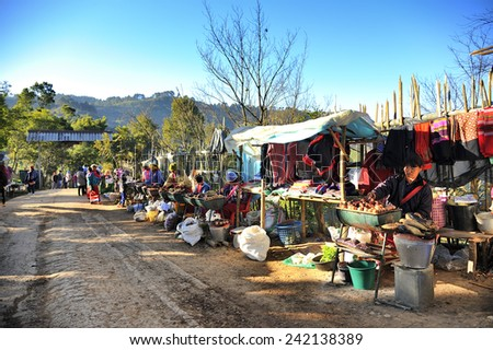 CHIANG MAI THAILAND - DECEMBER 31 : Doi Ang Khang Ethnic Market, Popular tourist food-fruit and visit the local market is be held everyday. on December 31 , 2014 in Chiang Mai, Thailand. - stock photo